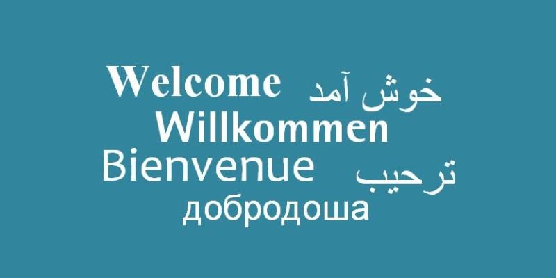 Bild mit Text Willkommen in sechs Sprachen