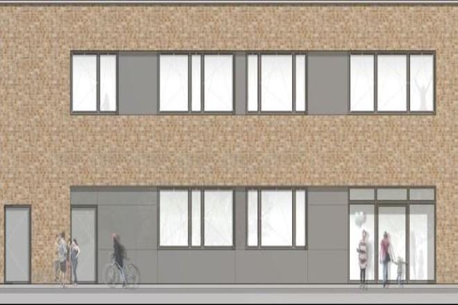 Visualisierung: Ausschnitt der Fassadenansicht des Erweiterungsbaus der Altfriedschule von Nord-West. Die Ansicht zeigt eine erdfarbene Ziegelfassade mit Türen und Fenstern.