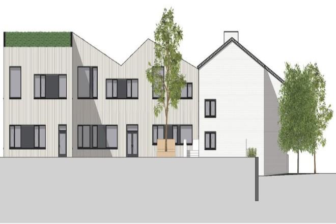 Die Visualisierung zeigt links die Fassadenansicht des Erweiterungsbaus, rechts das Bestandsgebäude der Andreasschule.