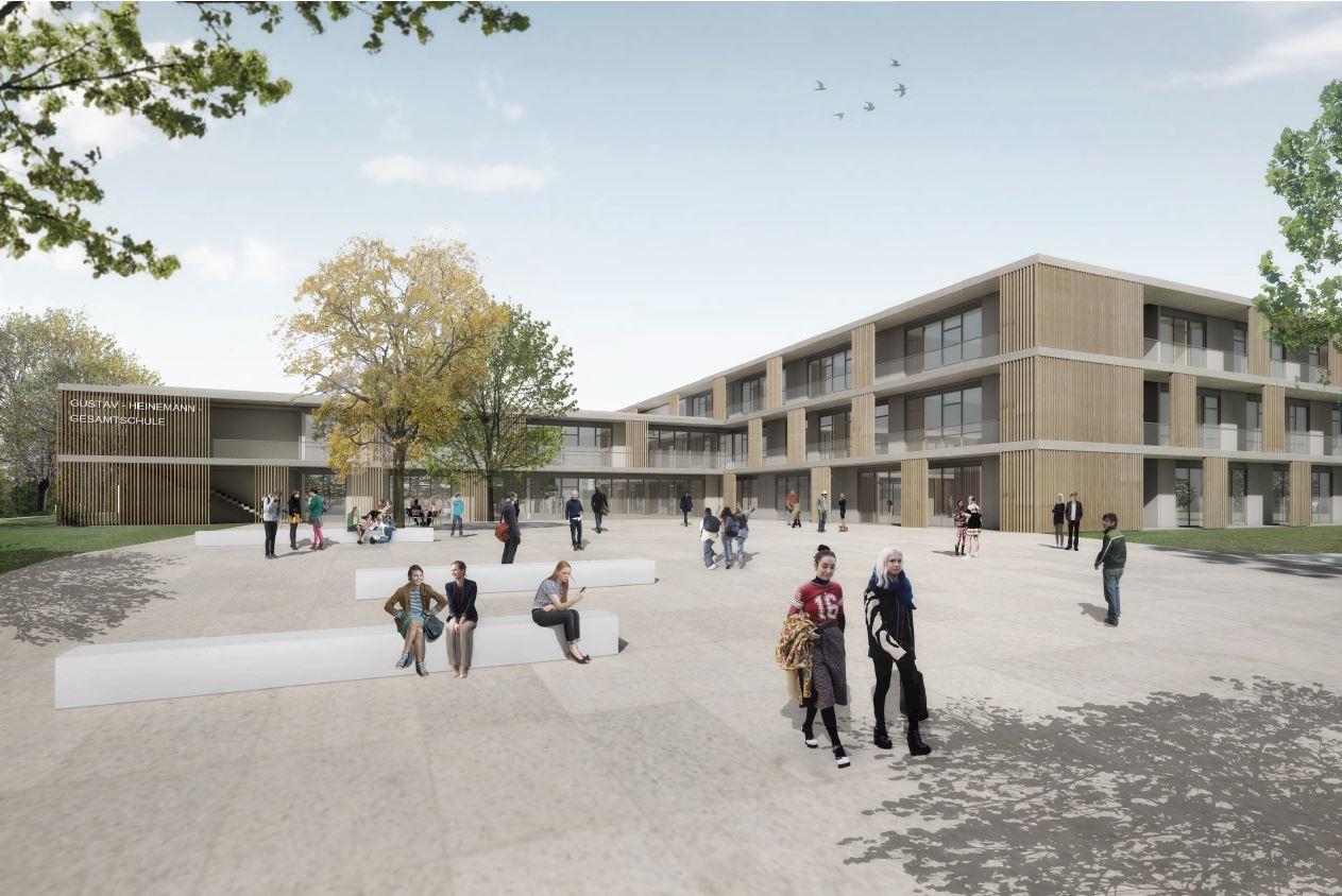 Visualisierung des Neubaus Gustav-Heinemann-Gesamtschule. Im Bildvordergrund der Eingangsbereich mit Sitzgelegenheiten und zahlreichen Schülern und Schülerinnen.
