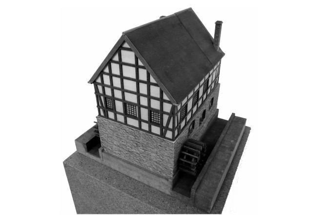 """Foto: """"Ausgedrucktes"""" 3D-Modell des Hammergebäudes im Institut für Denkmalschutz und Denkmalpflege. Das Untergeschoss bestand aus Stein."""